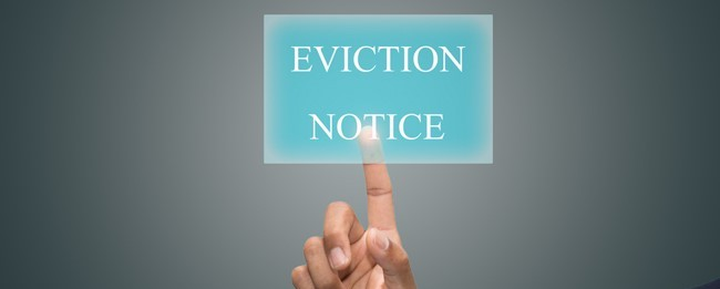 Houston property manager giving a residential tenant an eviction notice