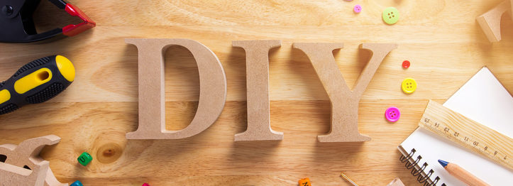 DIY Wood Font Style On a Wooden Workbench Top View.Do it Yourself concept