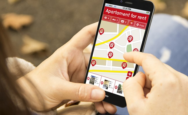 person locating katy texas apartments for rent on smart phone